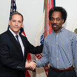 Administrative Assistant to the Secretary of the Army Mr. Gerald B. O'Keefe presents a coin to Willie Warren Jr. at the Pentagon in Arlington, Va., Feb. 15, 2017. (U.S. Army photo by Spc. Ta ...