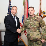 Administrative Assistant to the Secretary of the Army Mr. Gerald B. O'Keefe presents a coin to Chief Warrant Officer 4 James Meyers at the Pentagon in Arlington, Va., Feb. 15, 2017. (U.S. Ar ...