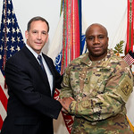 Administrative Assistant to the Secretary of the Army Mr. Gerald B. O'Keefe presents a coin to Staff Sgt. Andre Williams at the Pentagon in Arlington, Va., Feb. 15, 2017. (U.S. Army photo by ...