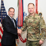 Administrative Assistant to the Secretary of the Army Mr. Gerald B. O'Keefe presents a coin to Col. Walter Rugen at the Pentagon in Arlington, Va., Feb. 15, 2017. (U.S. Army photo by Spc. Ta ...