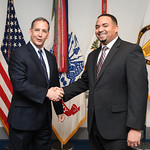 Administrative Assistant to the Secretary of the Army Mr. Gerald B. O'Keefe presents a coin to Mr. Luis Gonzalez at the Pentagon in Arlington, Va., Feb. 15, 2017. (U.S. Army photo by Spc. Ta ...