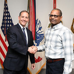 Administrative Assistant to the Secretary of the Army Mr. Gerald B. O'Keefe presents a coin to Mr. Dexter Edmonds at the Pentagon in Arlington, Va., Feb. 15, 2017. (U.S. Army photo by Spc. T ...