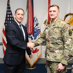 Administrative Assistant to the Secretary of the Army Mr. Gerald B. O'Keefe presents a coin to Staff Sgt. Jordan Thomas at the Pentagon in Arlington, Va., Feb. 15, 2017. (U.S. Army photo by  ...